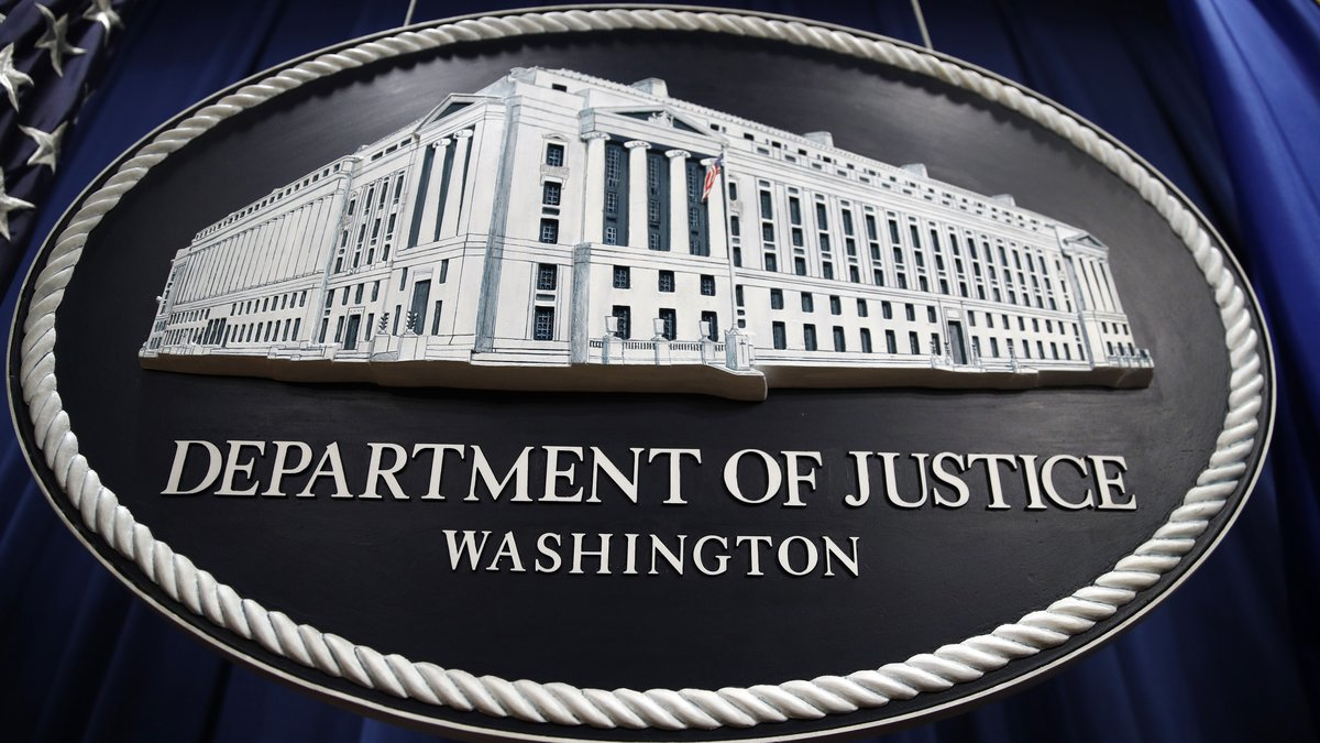 FILE - In this Thursday, April 18, 2019 file photo, a sign for the Department of Justice hangs...