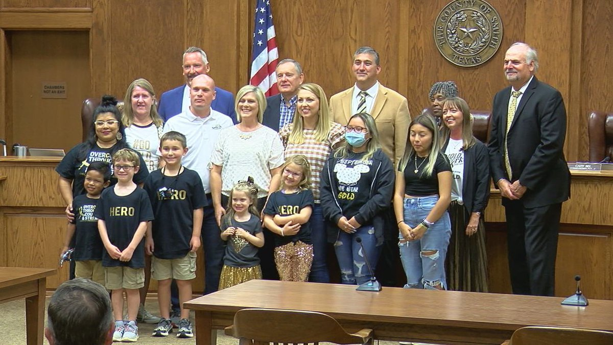 Gold Network of East Texas members stand with county commissioners and the county judge at...