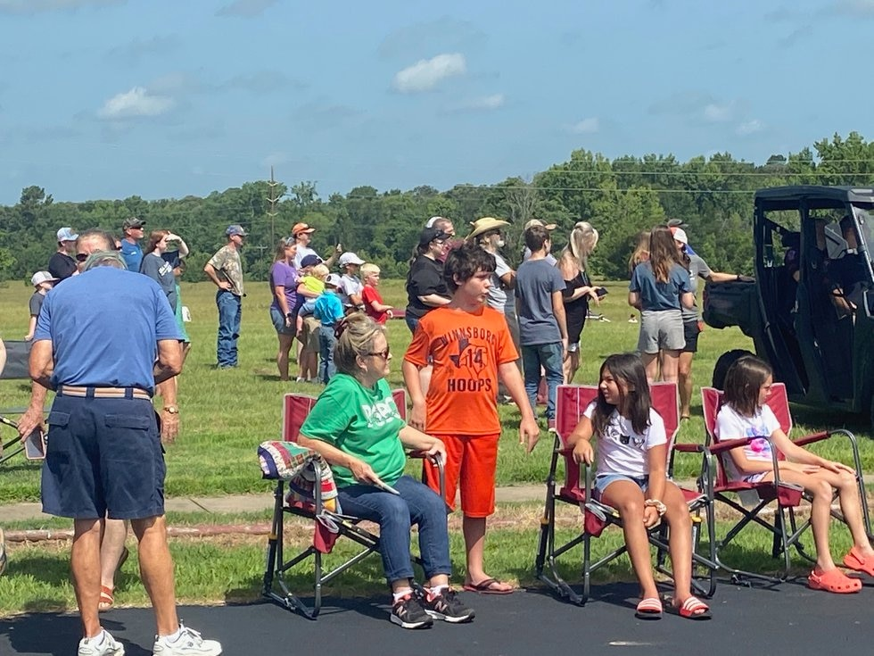 Crowd watching the helicopter's landing