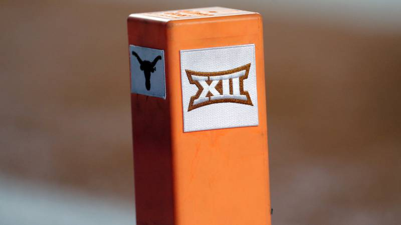 FILE - In this Sept. 15, 2018, file photo, the Big 12 conference logo is seen on a pylon during...