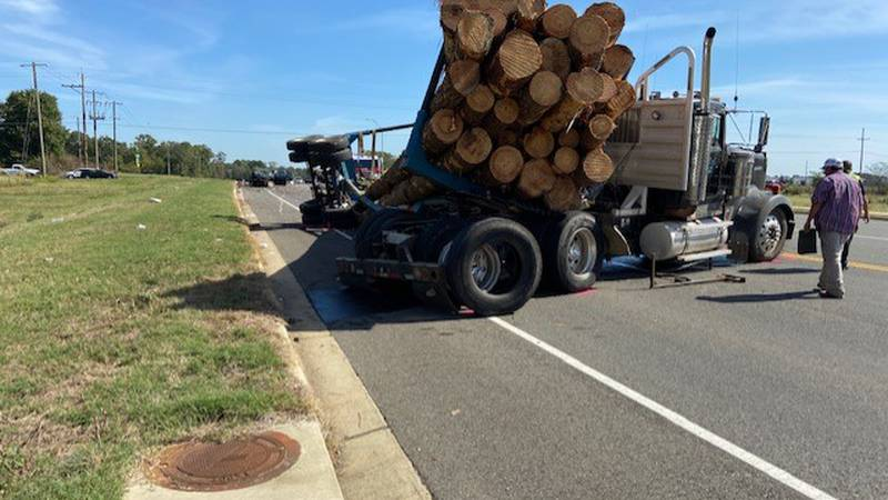 Crash involving log truck