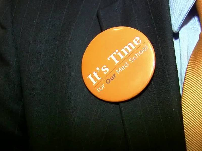 A button worn by the president of UT Tyler promoting the creation of Tyler's new medical school.