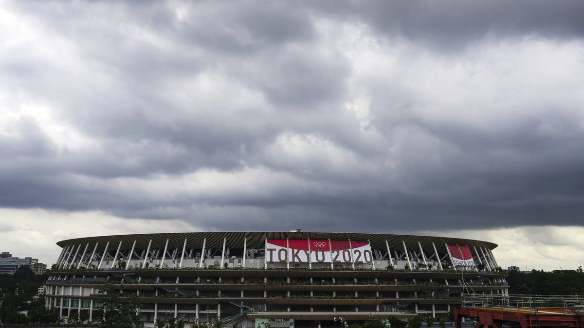 Rain clouds move in over National Stadium Wednesday, June 23, 2021, in Tokyo, one month before...
