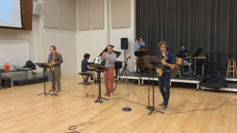 Members of the UT Tyler jazz program play socially-distanced performance for residents at a...