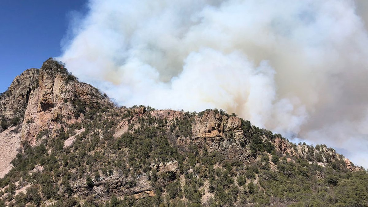 Smoke from a wildfire is visible on Big Bend National Park's Emory Peak Saturday afternoon.