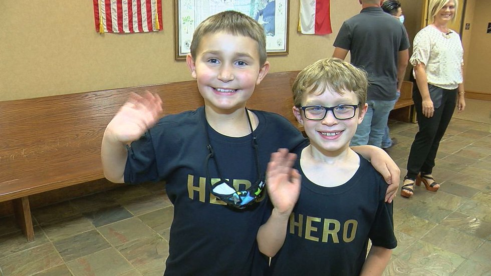"""Gold Network kids wore shirts saying """"HERO"""" for Tuesday's commissioners court meeting."""