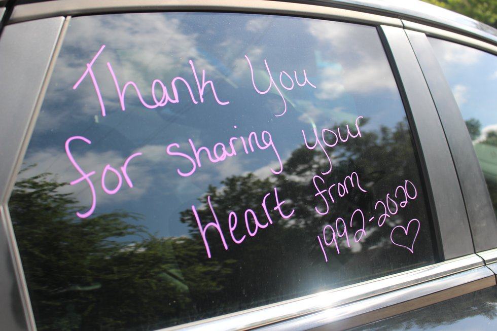 Painted cars show messages of gratitude for Greita Tallios during retirement party