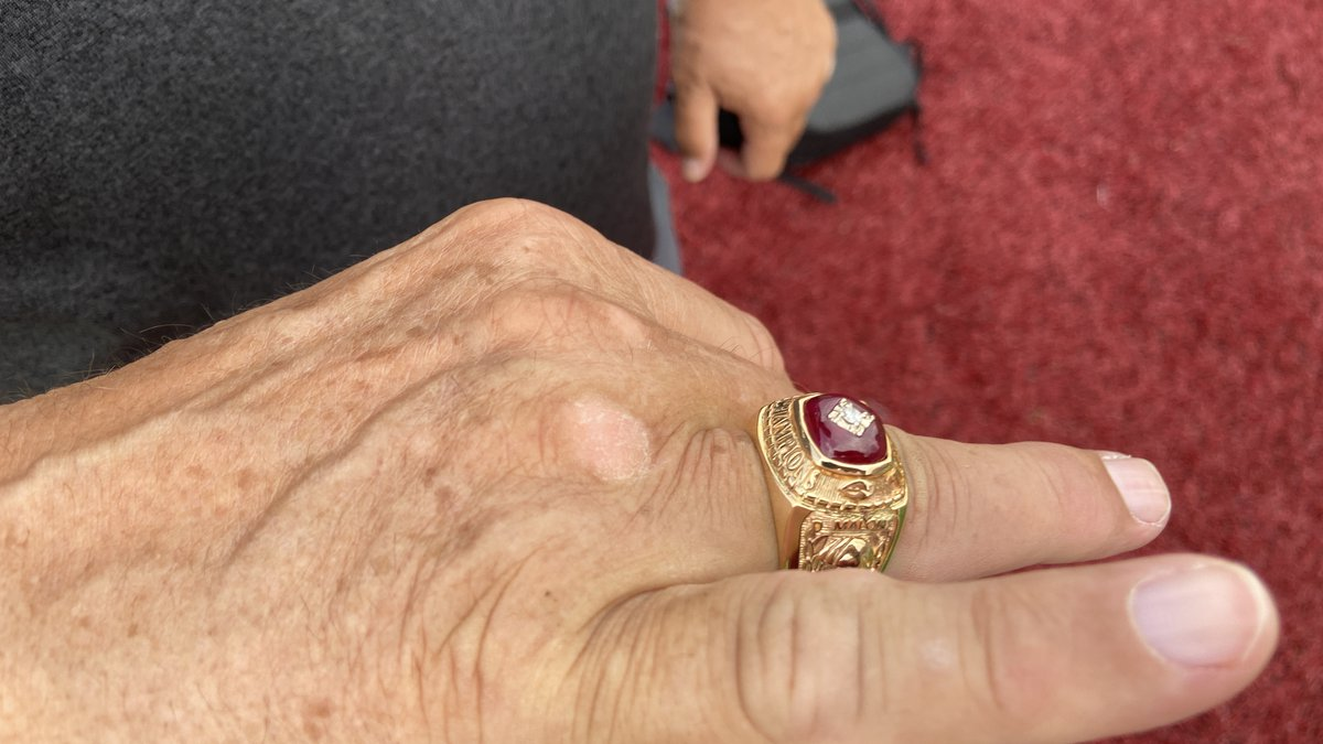 Coach Malone shows off his custom made 1970 Nebraska championship ring which was replaced by...
