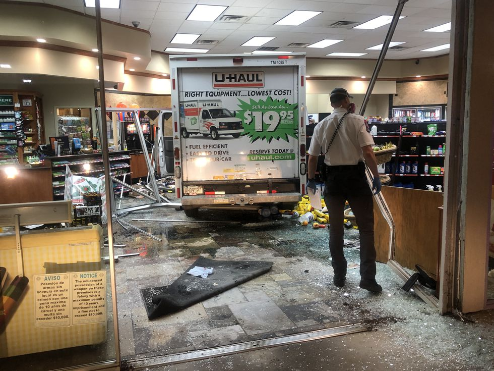 Driver crashes into convenience store with U-Haul, one injured
