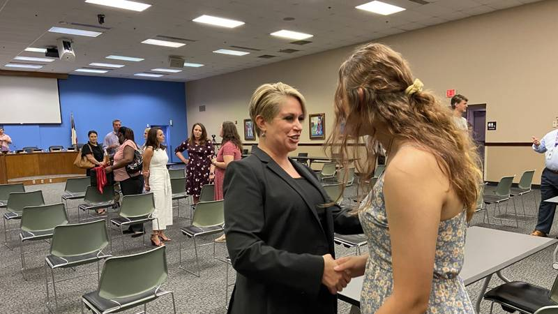 Dr. Kristen Wells (center, in black) was approved by the Tyler ISD Board of Trustees as the new...