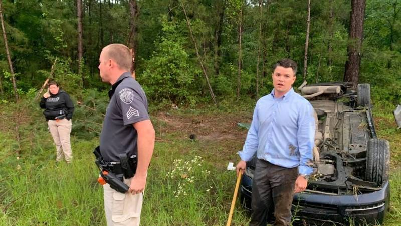 Trinity County Attorney Colton Hay (right) is seen in the aftermath of a single-vehicle crash...