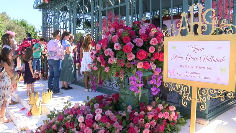 People line up to get photos with 2021 Texas Rose Festival Queen Anna Grace Hallmark during the...