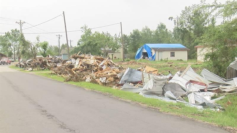 Wood and metal debris on side of road after tornado strikes Onalaska.