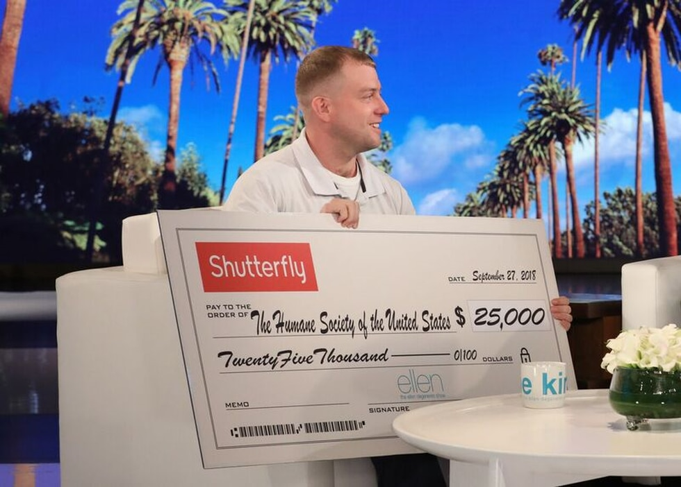 Ryan Nichols holds a $25,000 check for the Humane Society to be donated in his name. (Source:...
