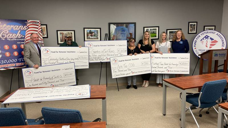 The Texas Veterans Commission poses with recipients of seven grants, adding up to more than one...