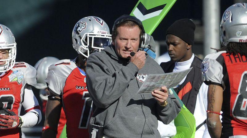 FILE - In this Nov. 27, 2010, file photo, then-Las Vegas head coach Jim Fassel, center, looks...