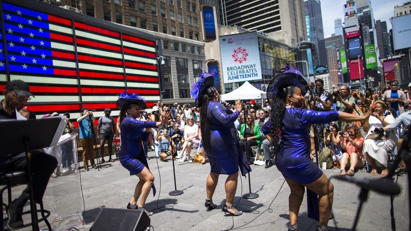 Selena Quinn, from left, LaVon Fisher-Wilson and Traci Coleman perform during a free outdoor...