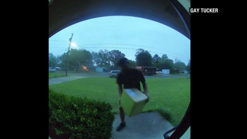 A door bell camera captured video of a UPS delivery driver running across the street to a...