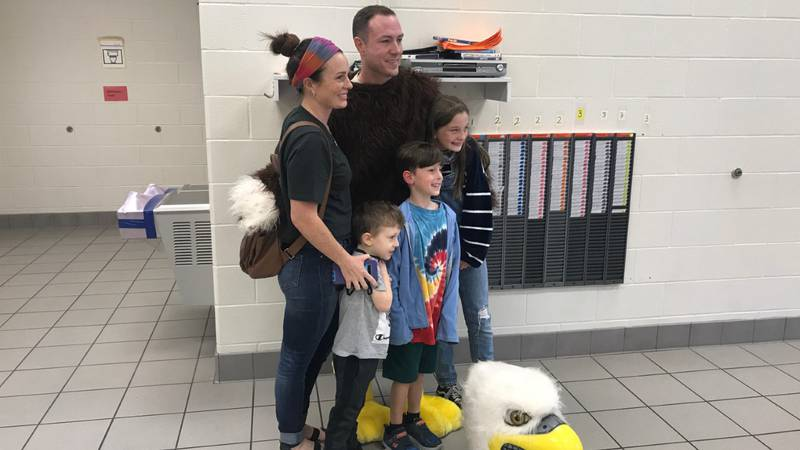 Navy Lt. William Chip Robertson stands with his wife, Lacy, and their three children -- ages 5,...