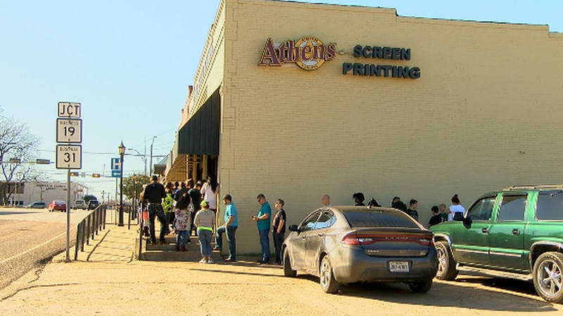 People wait in line at Athens Screen Printing to purchase maroon shirts in support of Athens ISD.