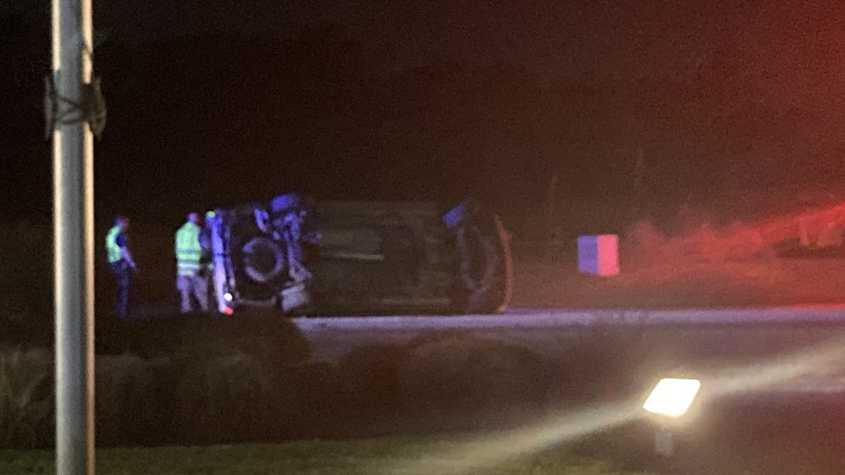 One vehicle is on its side