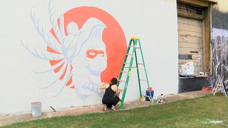 Spray paint, paint brushes, and creative minds brought color and culture to walls in Downtown...
