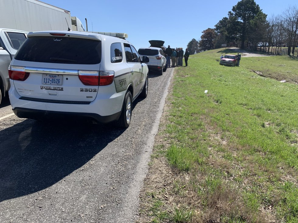 Henderson County law enforcement are seen by the side of the road where the suspect accused of...