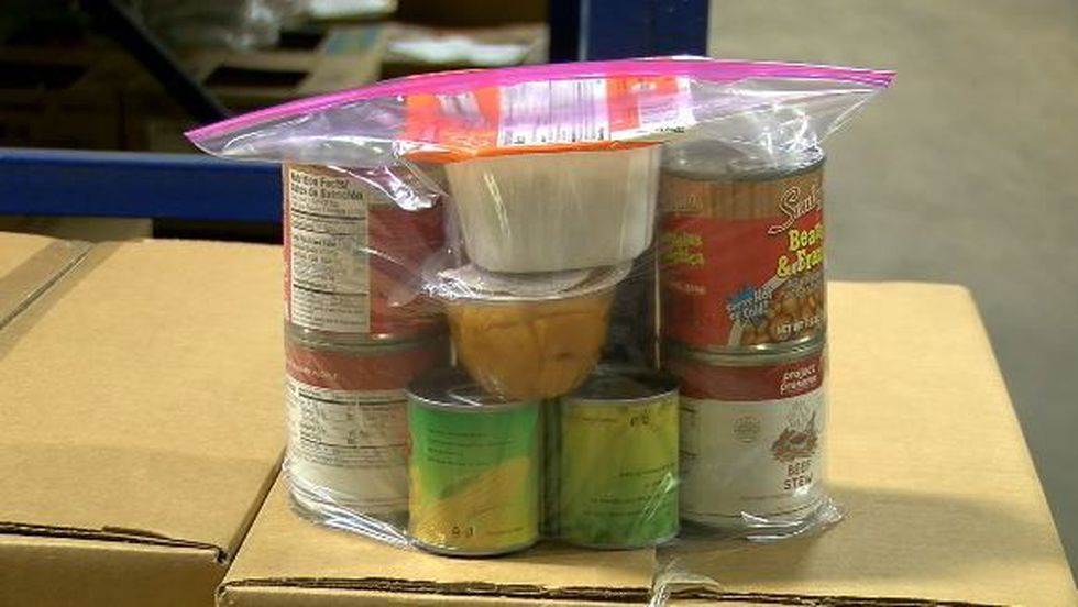 The summer food backpacks are fill with shelf-stable items like peanut butter, granola bars,...