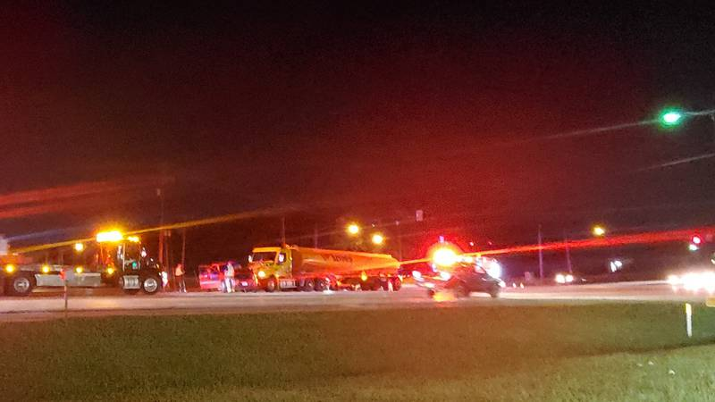 An oil tanker appears to have struck a pickup truck.