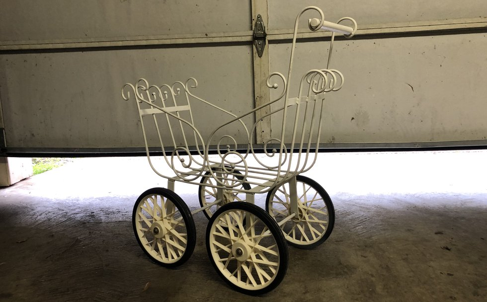 The carriage now resides in the garage and has been placed on Facebook Marketplace for $65.