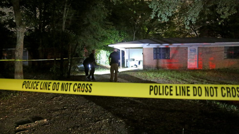 Crime scene tape is placed around a Lufkin home connected with the investigation of a fatal...
