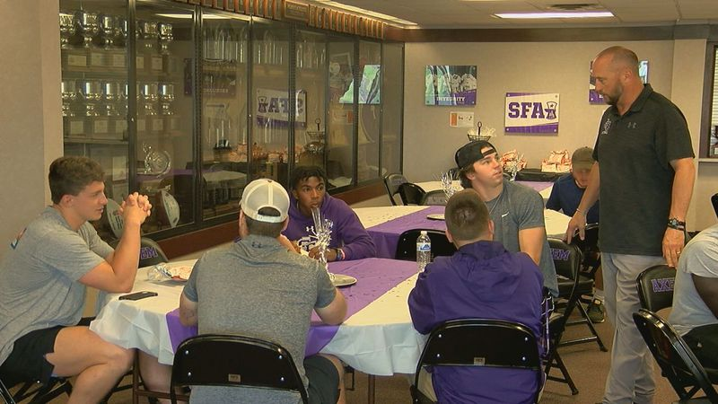 SFA head football coach Colby Carthel visits with incoming freshman student-athletes (KTRE...