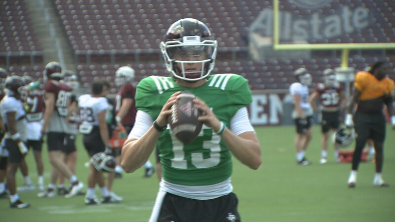 Texas A&M quarterback Haynes King warms up during practice at Kyle Field.