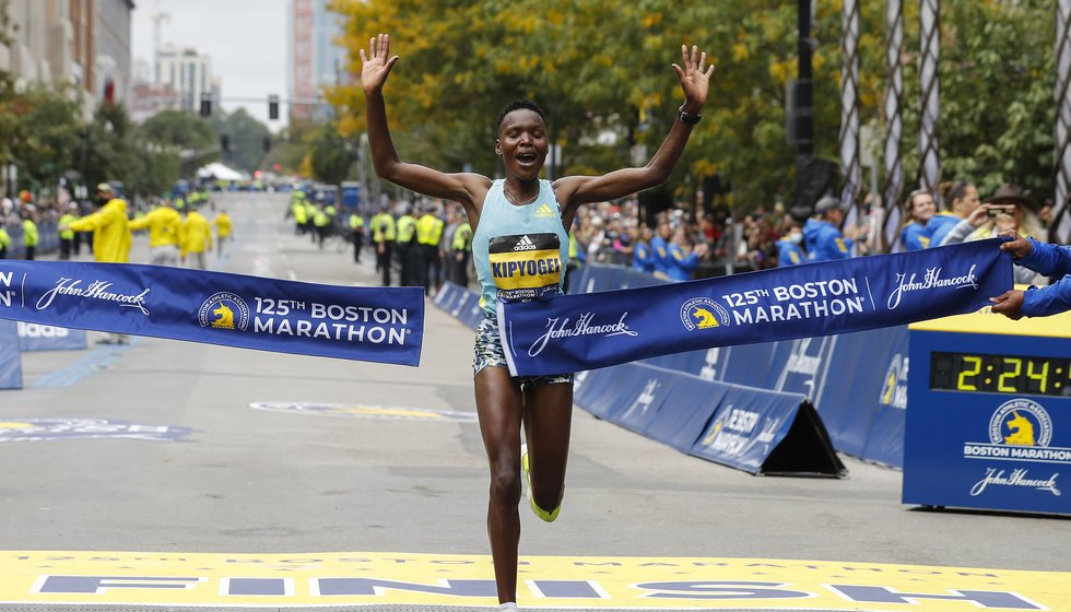 Diana Kipyogei, of Kenya, breaks the tape to win the women's division of the 125th Boston...