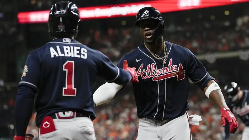 Atlanta Braves' Jorge Soler celebrates with Ozzie Albies after a home run during the first...