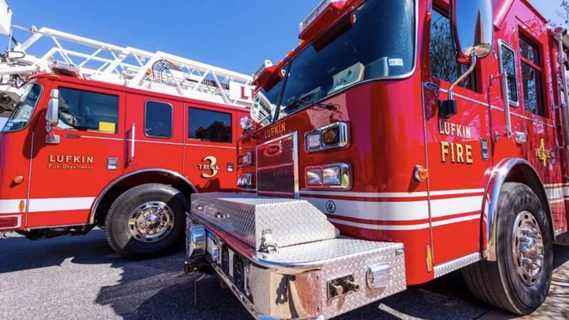 Lufkin fire trucks stationed in lot