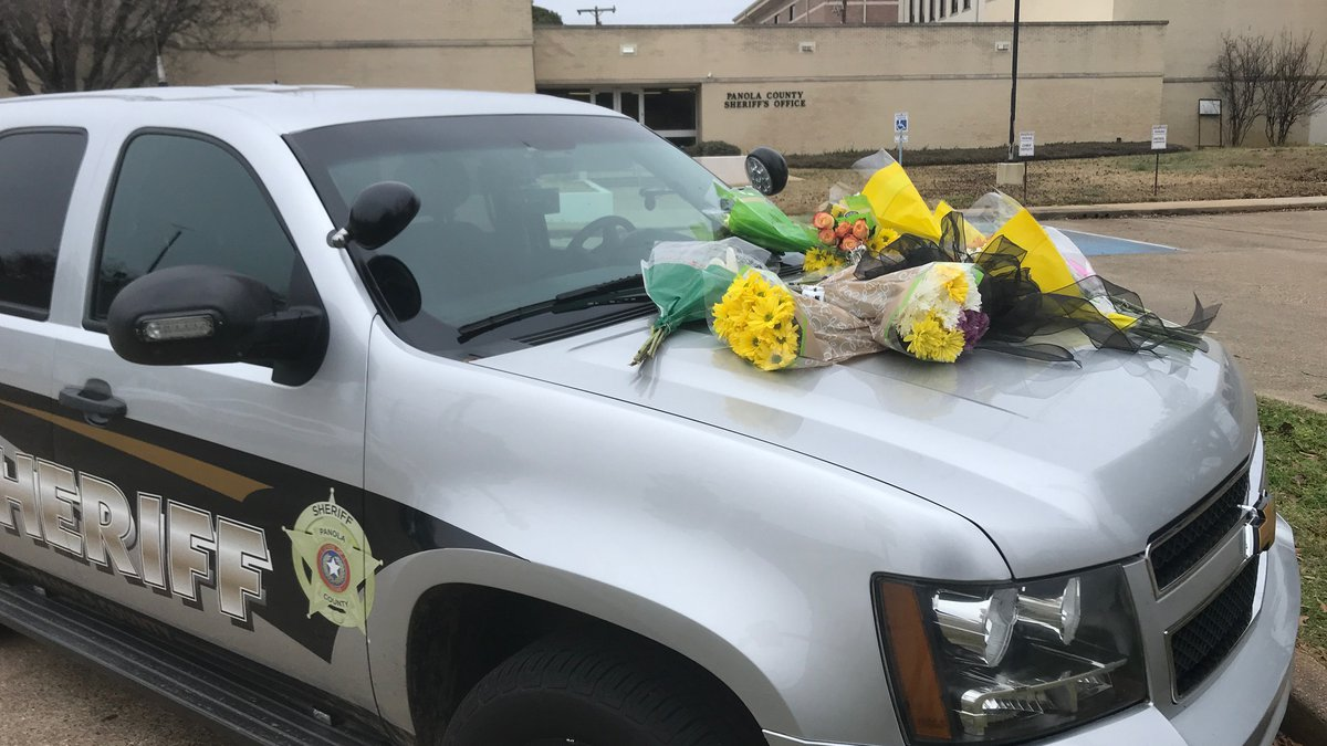People have started laying flowers on a Panola County Sheriff's Office patrol unit in his...