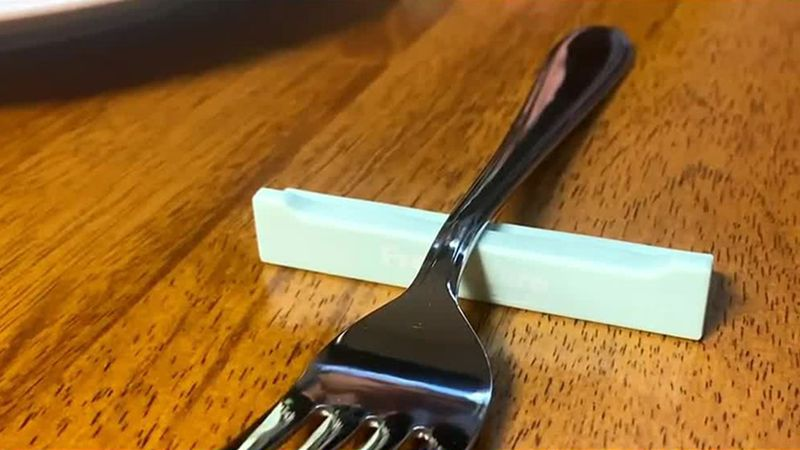 The device protects silverware at restaurants.