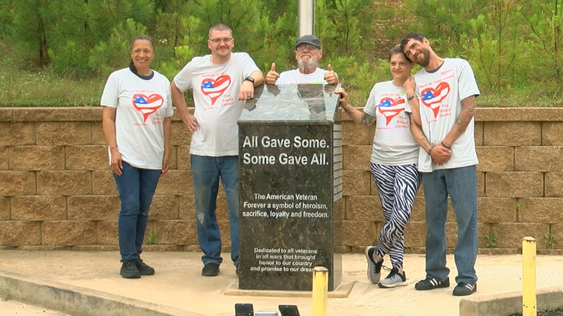 Some of the veterans that attended the Hearts for Heroes class posing for a photo.