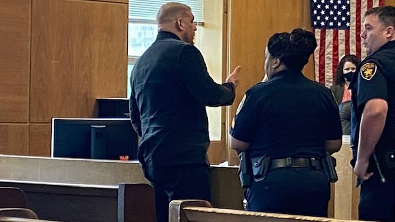 Joshua Black is speaking to deputies before being placed under arrest.