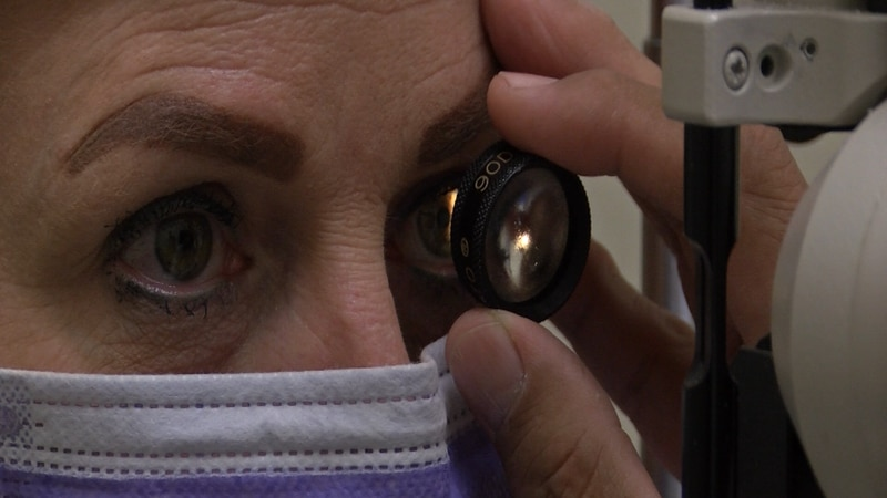 A patient's eye being examed.