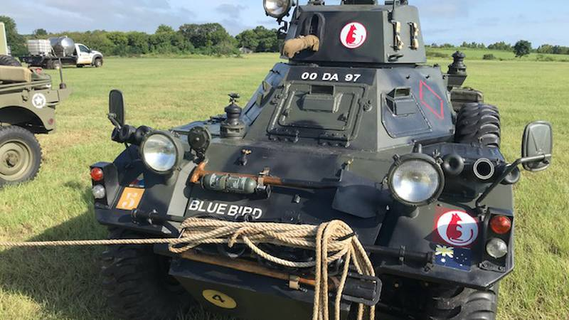 Military vehicles ready for weekend event celebrating veterans.
