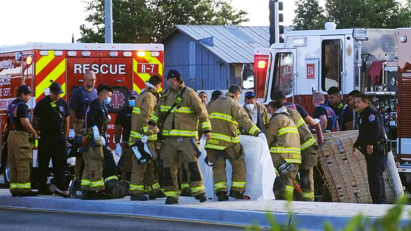 Albuquerque Fire Rescue crews work on victims of the fatal balloon crash at Unser and Central...