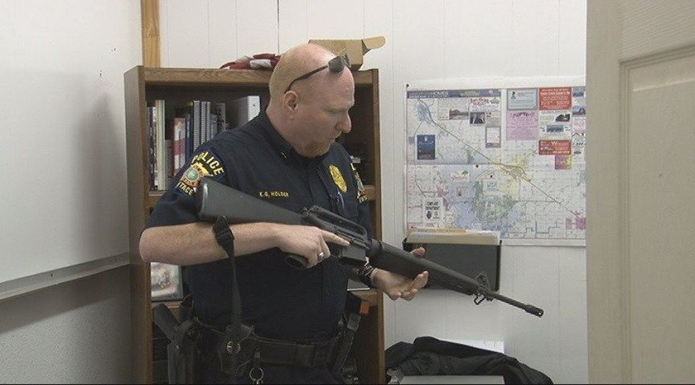 Former Eustace Police Chief Ken Holder shows an M-16 the department received from a military...
