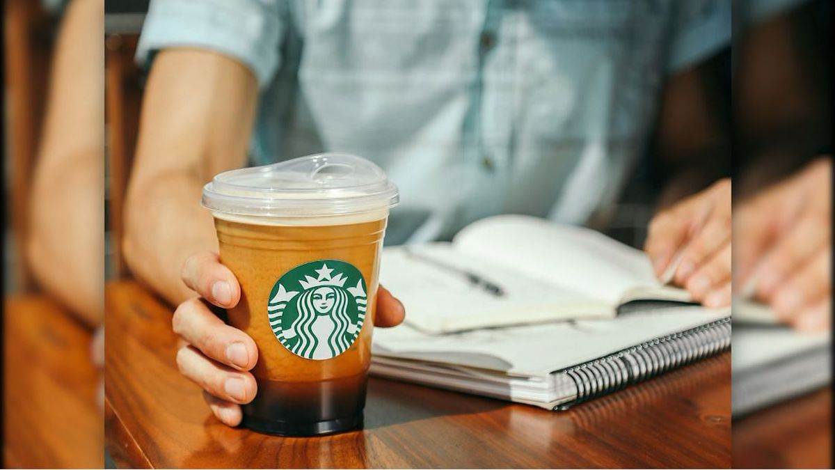 Starbucks has officially abandoned straws for its cold drinks in favor of lids with a drinking...