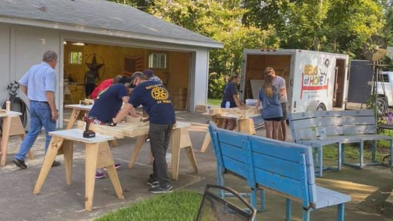 Volunteers work on dozens of beds during small August 2020 build event.