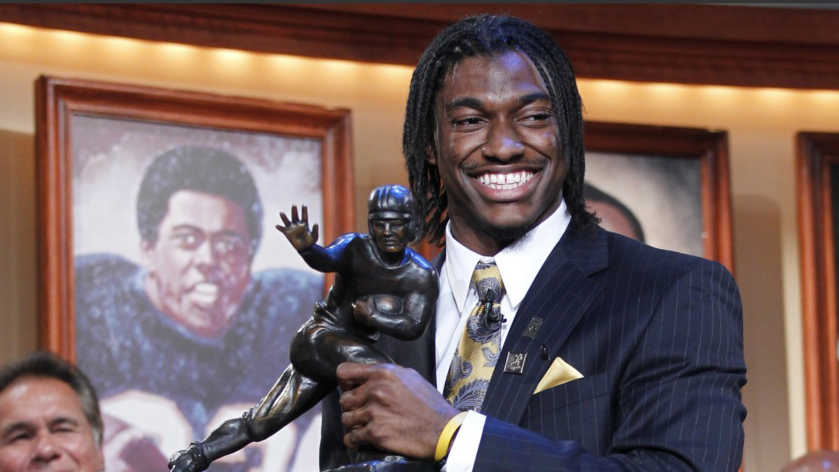 FILE - In this Dec. 10, 2011, file photo, Robert Griffin III, of Baylor University, holds the...