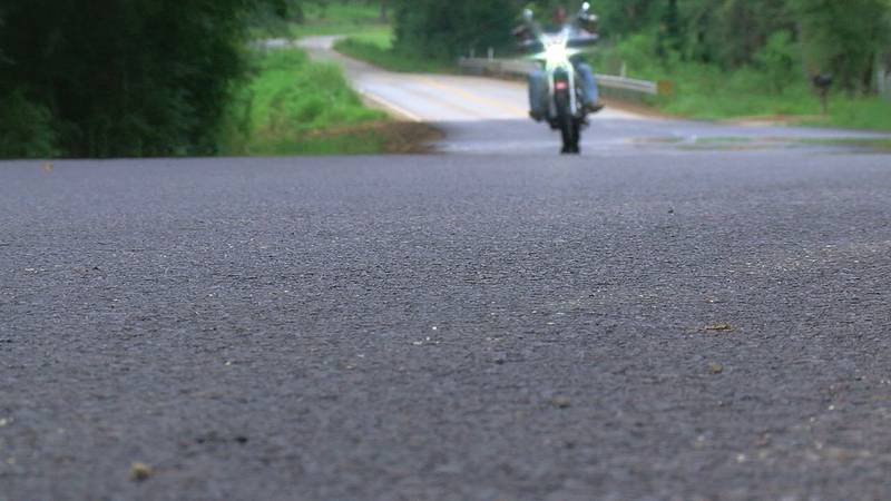 A motorcyclist can be seen driving down Lake Placid Road in Smith County.