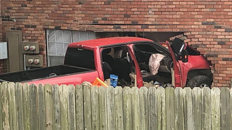 A pickup crashed into a Longview apartment Friday. (Source: KLTV Staff)