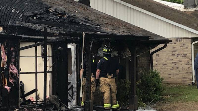 Woman, baby awakened by fire, escape unharmed